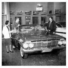 On the showroom floor… '61 Impala convertible (and some time-wasting kids who can't buy anything)