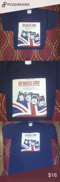 "Beatles Album Cover tee Fruit of the loom - 100% cotton navy t shirt (hard color to find), featuring ""The Beatles' Story"" LP graphic with George, Paul, John & Ringo and the U.K. Flag. Collectors item for any fan, for sure.  Good condition, stitching at bottom of tee undone (see pic 4) fold still in place, but otherwise in great shape. Fruit of the Loom Shirts Tees - Short Sleeve"