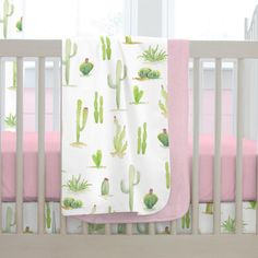 """Baby Blanket in Watercolor Cactus by Carousel Designs.  Our soft and lightweight crib blanket is just the thing to wrap your baby up, snug as a bug in a rug. At 34"""" x 43"""", it's the perfect size for the newest addition to the family."""