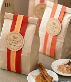 I like this style for wrapping... Brown paper bag, top folded over, wrapped with ribbon.