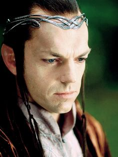 Elrond, lord of Imladris. Because he and his brother had human blood, the Valar offered them a choice: to stay among Men, or among the Elves. Elrond choose to remain immortal; his brother Elros, however, became a mortal. He was a great king in Numenor and was an ancestor of Isildur and Aragorn.