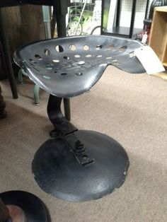$45 - This vintage tractor seat has been used to create a spring stool. The base as well as the seat have been painted black. The seat measures 18 inches across and stands approximately 18 inches tall. It can be seen in booth D5 at Main Street Antique Mall 7260 East Main St ( E of Power Rd ) Mesa 85207  480 9241122open 7 days 10 till 530 Cash or charge accepted