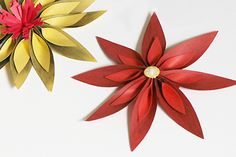 Starburst flower    With just paper and simple materials make this flower that would make a wonderful addition to any gift wrap idea or place it in a frame box for a simple (and economic!) wall art décor piece.