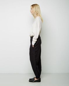 wide tapered trousers + tucked loose long-sleeved tee + loafers