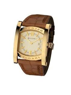 Bvlgari 18k Yellow Gold Assioma. 18k Yellow Gold Case on a Alligator Strap with a Ivory Dial and Date Display. Automatic Movement. Available at London Jewelers.