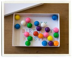 write message in bottom of box, fill with m&m's or gumballs and wrap.  good for Christmas too!