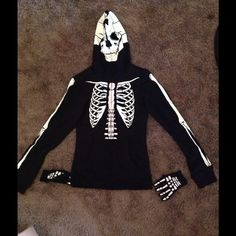 NWT teenage runaway skeleton hottie mask hoodie NWT black zip up. This zip hoodie features a glow-in-the-dark skeleton design along the front, back, sleeves and hood. It even includes fingerless gloves. Zips all the way up to mask face. Please feel free to ask questions. No trades please pp preferred. Thanks for looking!  Small Teenage runaway Sweaters