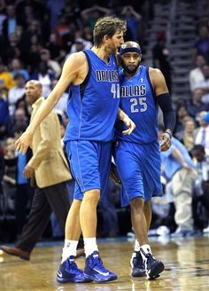 Dallas Mavericks guard Vince Carter (25) is congratulated by forward Dirk  Nowitzki (41 43b604cca