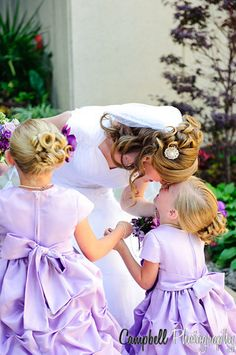 Bride and her flower girls.  So cute.