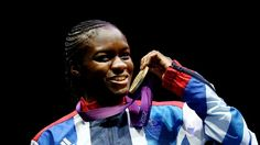 Gold medalist Nicola Adams of Great Britain celebrates on the podium during the Victory Ceremony after defeating China's Ren Cancan in the women's Fly (51kg) Boxing final bout on Day 13.
