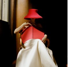 Woman in Red Hat with Book by Rodney Smith