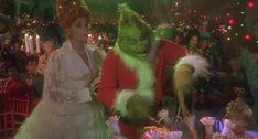 The Grinch and Martha May as the the Grinch carves the Roast Beast