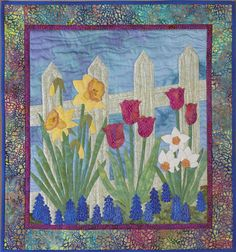 """Spring Border"" from Applique The basics & beyond by Janet Pittman. You can make gorgeous appliqué quilts like this one with Janet's amazing book. She even gives directions on embellishing your quilting projects with embroidery stitches, beading, and more! Find it online: http://landauerpub.com/Applique-The-basics-beyond.html"