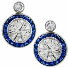 Art Deco Style 7.04ct Round Cut Diamond 2.00ct French Calibre Cut Sapphire 18k White Gold Earrings - See more at: http://www.newyorkestatejewelry.com/earrings/estate-7.04ct-diamond-2.00ct-sapphire-gold-earrings/25075/5/item#sthash.1NNbFOOP.dpuf