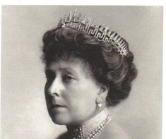 Princess Beatrice of Great Britian in 1911. Beatrice wears an unusual split level tiara, a Greek-key pattern tiara surmounted by Queen Victoria's sunray diadem, wherabouts unknown.  The 9th child of Queen Victoria, Beatrice was private secretary of her mother 1874-1901, and she is famous for editing the journals and diaries of Queen Victoria after her death.