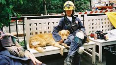 Bretagne, seen here with Carliss in 2001, is credited with not only helping find people trapped in the rubble but comforting the first responders.