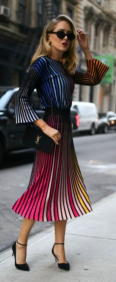 Click for outfit details!  Striped multicolored long sleeve sweater, coordinating striped pleated multicolored midi skirt, gold sculptural earrings and black ankle-strap pumps {Kenzo, M2Malletier, fall fashion, colorful dressing, midi skirt, classic dressing, classy style}