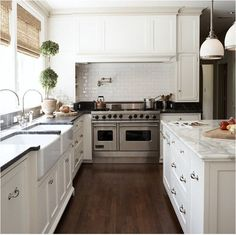 white kitchen - love the water faucet over the stove