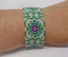 handmade purple and green flower pattern beaded bracelet #Handmade #Beaded