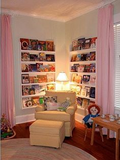 Like narrow shelves with book covers facing out.  We could so do this in the girls' room.  I love it.