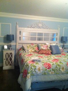 I made this wonderful headboard from an old french door I found in our barn. I used mirrored scrapbook paper for the mirror tiles and coated them with varnish.