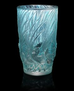 René Lalique 'Coqs et Plumes' a Vase, design 1928 frosted and polished glass, heightened with blue staining 15.2cm high