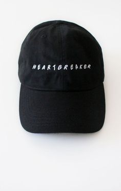 35f88d8b3f1 Description Details  Black six panel cap with  heartbreaker  embroidery    adjustable back with tri-glide buckle.All accessories are final sale.