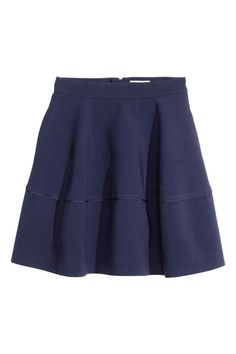 Flared skirt: Short, flared skirt in sturdy, heavily draping fabric with a seam and decorative trim, side pockets and a visible zip at the back. Unlined.