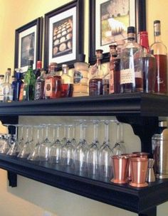 Use shelves to create the bar, get a cute, functional table to use as a mixing/cutting station. I'd probably hang the glasses from the shelves if possible.