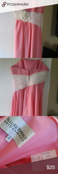 Size 2 salmon knee length dress Salmon pink with ivory flower sash. Removable straps. Strapless. Flowy, chiffon. See pic 4 for how it looks on. Worn one time in my sister's wedding. Great condition. No stains or rips. Allure bridal. Bridesmaid dress. Allure Dresses Strapless