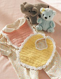 This sweetest baby bib is sure to be mom's favorite. Gentle colors and pretty lacy trim. (Yarnspirations)