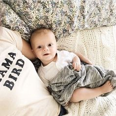 Sweet baby bird with our gray textured swaddle.