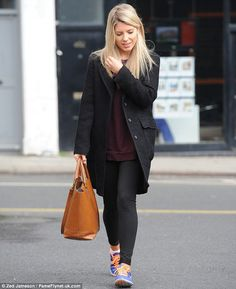 Low-King: Unlike her bandmates, Mollie opted for mostly dark hues including a long black coat and cropped leggings