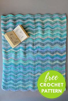 """Inchworm Baby Blanket Designed by Universal Yarn Design Team Completed Blanket Measures: 35"""" wide x 41.25"""" long Download Pattern You will need: * 2 balls each of 2 colors Universal Major Yarn, shown in # 103 Capri and #105 Aloe * Size J/10 (6.0mm) crochet hook"""