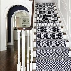 Amazing foyer features a traditional staircase lined with a navy geometric stair runner. Navy Stair Runner, Staircase Runner, Stair Runners, White Staircase, Stairway Carpet, Carpet Stairs, Hall Carpet, Entrance Foyer, House Entrance