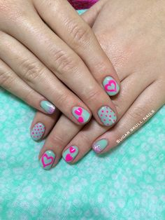 Pistachio green gel overlay with neon pink dots and hearts nailart