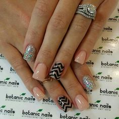 Glitter and tan nails with black stripes