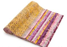 """We can't get enough of the golds, reds and purples in the Timeless Treasures 10"""" Tonga Treats Gelato collection! Click """"Repin"""" if now you want ice cream! #quilting #fabricdeal"""