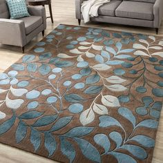 Beautiful and stylish, this rectangular floral rug is the perfect way to make a room feel more comfortable. The rug is crafted with a luxurious 0.75-inch polyester pile and features a natural blue-and-mocha print that enhances your decor.