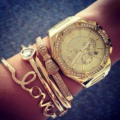 watch and bracelets in gold