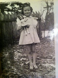 Little girl with her doll, circa 1930's -1940.