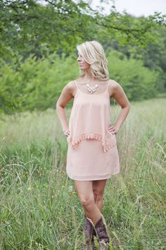 "This dress looks ""Just Peachy"" on everybody! Great flowing body with a flouncy top and crochet/lace detailing. Pair with your favorite boots and you'll be the talk of the event!"
