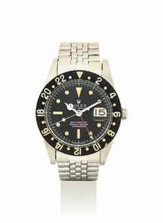 ROLEX. A STAINLESS STEEL AUTOMATIC DUAL TIME WRISTWATCH WITH SWEEP CENTRE SECONDS, DATE AND BRACELET