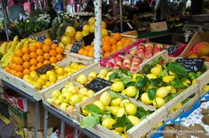 COURS SALEYA, NICE ~ Fresh fruit and vegetables line the long market, with colorful awnings shielding them from the sun