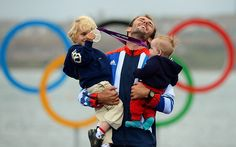 Family man: Nick Dempsey celebrates winning silver in the men's RS-X sailing with his sons Thomas-Flynn and Oscar. His wife, Sarah Ayton, herself an Olympic champion sailor, gave up her career to raise their sons so that he could follow his dream of an Olympic medalPicture: AFP
