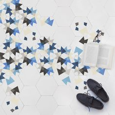 Keidos tiles with colourful geometric patterns by MUT for eintic designs at Clerkenwell Design Week 2013.