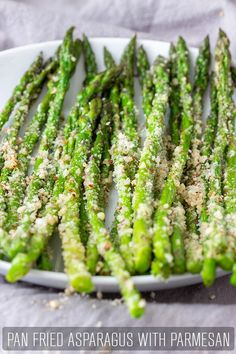 Pan Fried Asparagus with Parmesan - Happy Foods Tube Pan fried asparagus with Parmesan is a tasty side dish ready in minutes. It's cheesy and crunchy and goes well with any kind of dinner – fish, chicken, steak, turkey or pork. Steak Sides, Steak Side Dishes, Side Dishes For Chicken, Dinner Side Dishes, Vegetable Side Dishes, Steak Dinner Sides, Fried Fish Side Dishes, Turkey Side Dishes, Pan Fried Asparagus