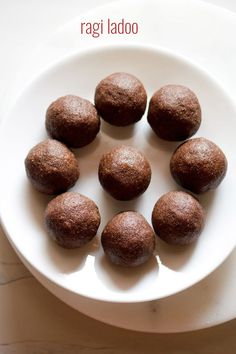 ragi ladoo recipe with step by step photos - quick, easy and tasty ragi ladoo made with three ingredients - ragi, jaggery and ghee. ragi or nachni or finger millet is a healthy grain and should Indian Dessert Recipes, Indian Sweets, Indian Snacks, Healthy Dessert Recipes, Sweets Recipes, Baby Food Recipes, Gourmet Recipes, Snack Recipes, Cooking Recipes