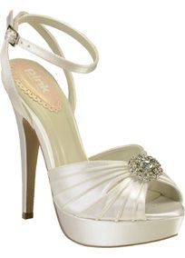 """Pink Paradox London Platform Sandal is a stunning high heel pleated platform that is a must-have for your shoe collection!  Mimosa platform sandal comes with a lovely cross over ankle strap and pleated vamp with vintage crystal trim.  Materials: White Satin.  Heel: 4 3/4"""" heel.  Imported."""