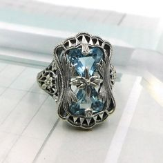 Victorian/Art Deco Style Blue Topaz Flower Filigree Ring Sterling Silver This is a sterling silver reproduction design from an authentic Victorian jewelry piece Victorian Jewelry, Antique Jewelry, Vintage Jewelry, Victorian Art, Vintage Rings, Jewelry Rings, Jewelery, Jewelry Accessories, Art Deco Schmuck